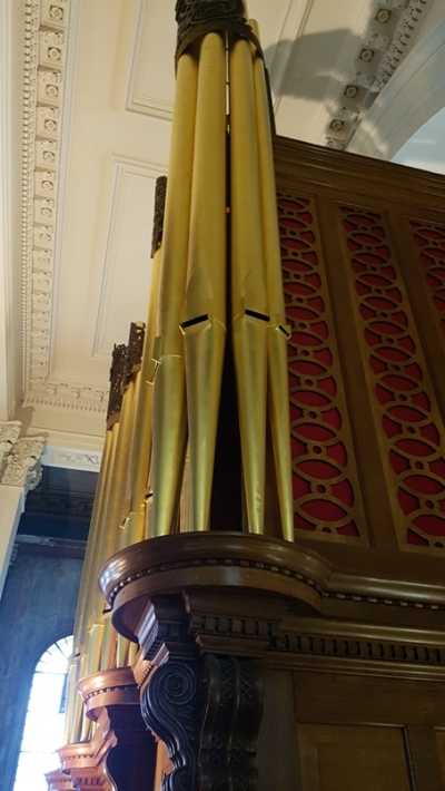 Close up view of the organ pipes, painted gold