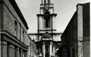 Black and white photo showing the church from outside, from Newell Street
