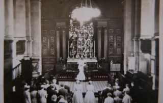 Black and white photo showing a wedding at St Anne's, date unknown